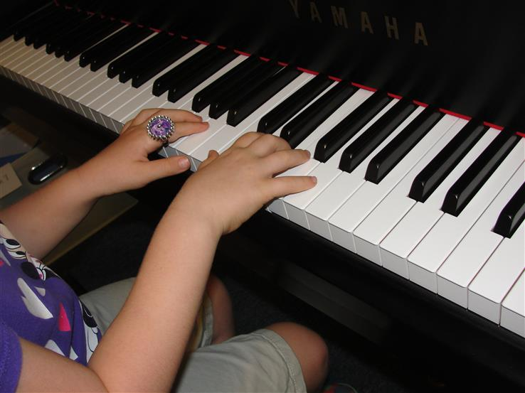 Student of Barwell Flute and Piano Studio playing piano in Jacksonville, FL